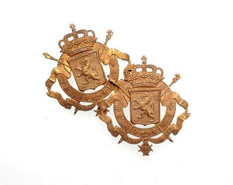 Coat of arms charms, raw brass