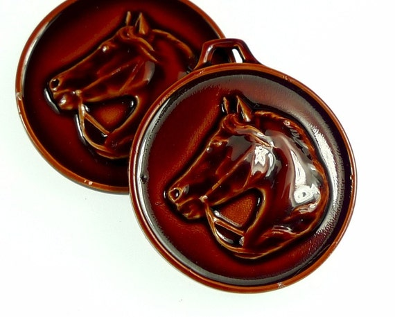 Horse head charms, enameled red brown