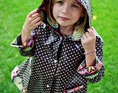 Little girl's brown-and-pink polka dot raincoat, size 6