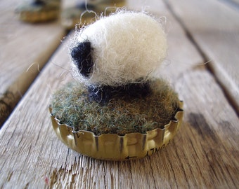 Felted wool sheep in an upcycled bottlecap