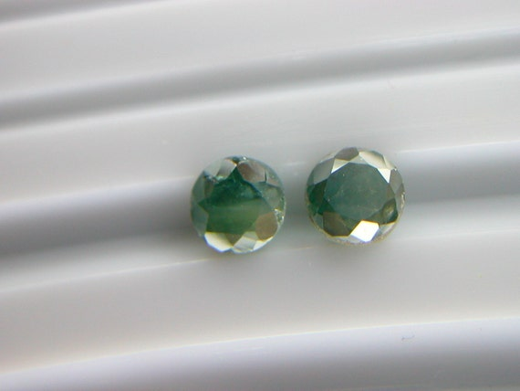 BLUE/Green DIAMONDS. 2 Pieces. matched pair. Conflict Free. 2 pieces. Round Brilliant Cut. Very Sparkly. 0.39 ctw. (DIA93)
