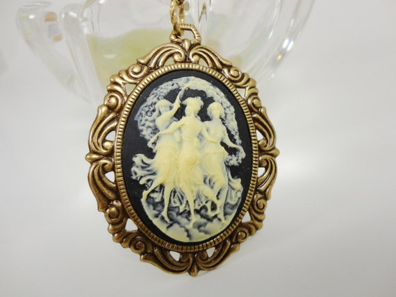 Victorian Inspired Three Nymphs Black and Cream Cameo on Brass Necklace by Dr Brassy Steampunk