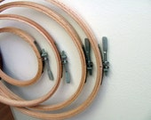 4 Embroidery Hoops Wood Long Screw Marked Made in USA All one Price.