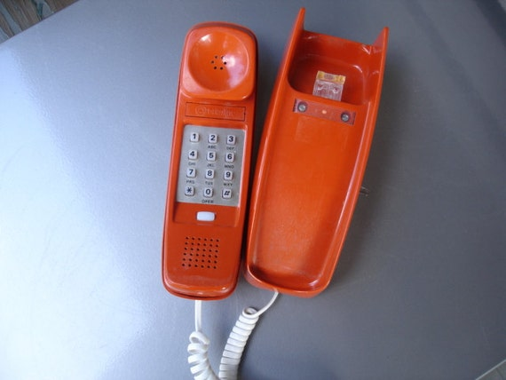 Awesome Vintage Retro Orange Trimline Wall telephone- Check out all of our vintage telephones