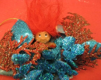 Ornaments featuring real crab shells with 3D dioramas