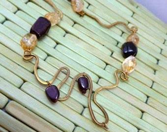 Bold and Elegant Calder-Style Brass, Citrine and Garnet Necklace