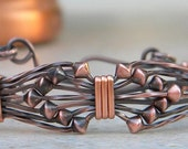 Ribbons and Bows Copper Bracelet