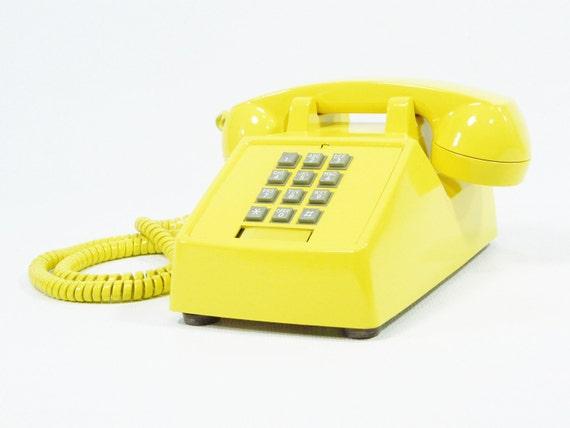 Vintage telephone yellow push button phone