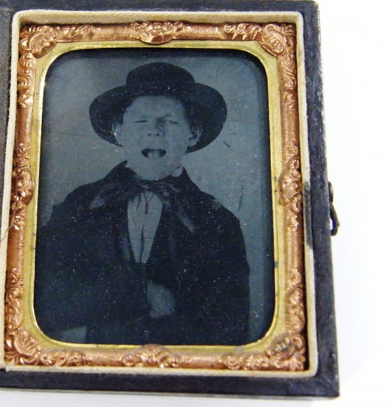 Antique Tintype photo screaming boy in arm brace