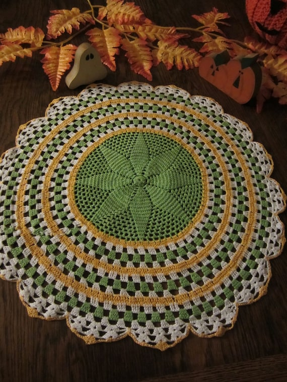 Vintage crochet doily in yellow, green and white