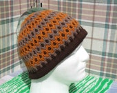 Handmade knit men's hat in orange, light and dark brown