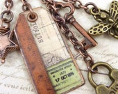 Assemblage Charm Necklace Vintage Style Mixed Metal Resin Tag Lock Key Star