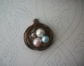 Antiqued brass bird's nest pendant (multicolored glass pearls)