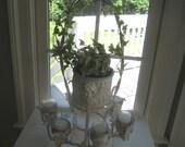 White iron plant/candle/wine holder