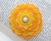marigold and mustard yellow felt flower clip or headband with vintage pearl button