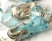 Asymmetrical Necklace - Lampwork Glass Beads, Sterling Silver and Blue Topaz