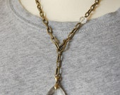 Unique Striped Brass Necklace with a Vintage Faceted Crystal