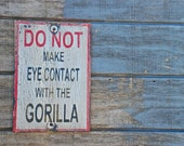 DO NOT make eye contact with the gorilla sign made from reclaimed plywood