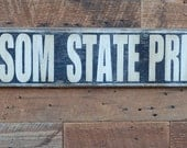 FOLSOM STATE PRISON sign made from reclaimed wood