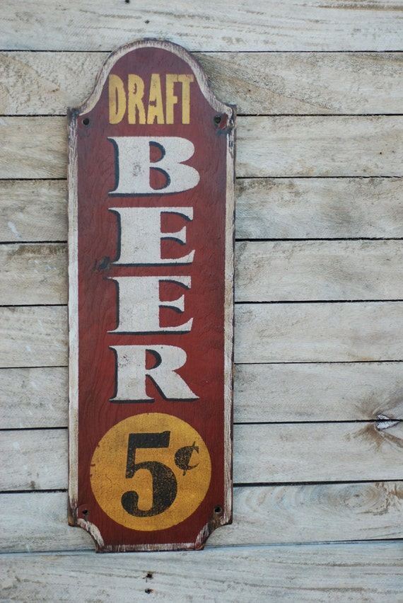 Old nickel beer sign made from reclaimed plywood