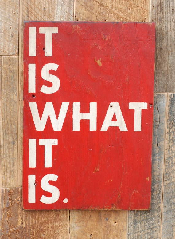 It is what it is sign made from reclaimed plywood