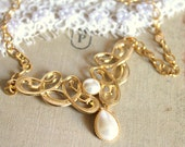 Elegant  celtic 14k gold plated gold and pearls necklace .