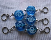 Blue primitive spiral stitch markers for knitting
