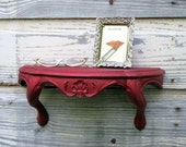 zomg, fancy RED GLITTER SHELF, Dorothy -- glittery rococo wall piece -- studio 54 style