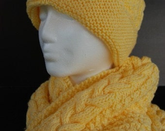 Hat and scarf in yellow cables
