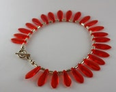 red glass dagger beads with sterling silver capsule beads and toggle clasp