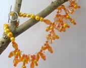 Spiky orange beaded choker