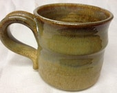 Shimmery gold porcelain coffee fat mug