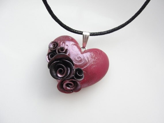 Red heart necklace with black roses on black cotton cord