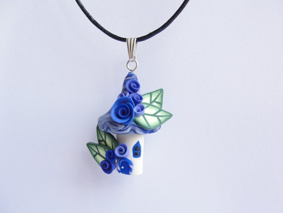 Fairy house childrens necklace in blue and indigo colours handmade from polymer clay on black cotton cord