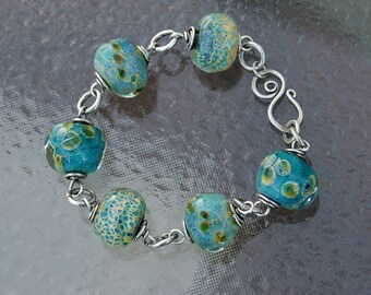 RESERVED for Diane  Handcrafted turquoise lampwork and sterling silver wrapped bracelet titled Blue Lagoon SRAJD