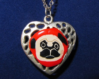 Clay pug face on metal heart pendant