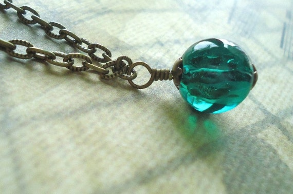 Solitary Teal.A Single Teal Glass Ball on Textured Oxidized Brass Chain.