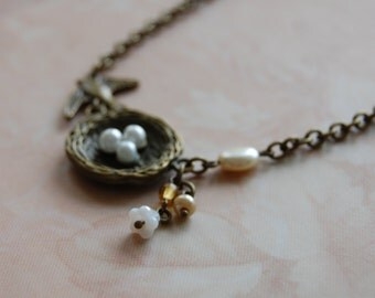 bird nest with pearls necklace