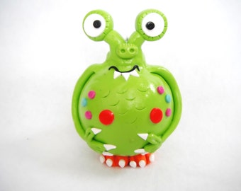 Christmas Ornament Little Monster handmade glass covered polymer clay ornament