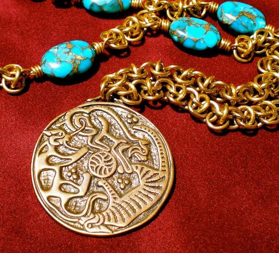 Celtic Cats a bronze triskele necklace