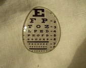Eyeglass lens with eye chart, fridgie magnet