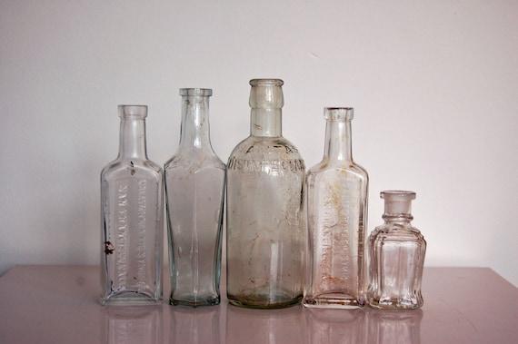 Clear glass bottles vintage british household bottles for Uses for old glass bottles