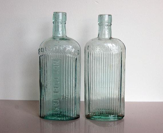 Vintage poison bottles aqua glass bottletwo antique for Uses for old glass bottles