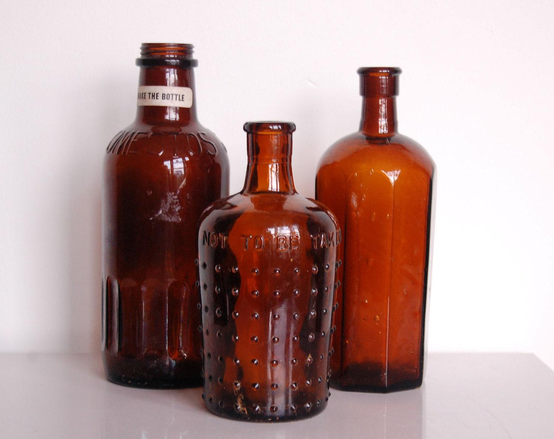 Amber glass bottles vintage brown bottle set of three for Retro glass bottles