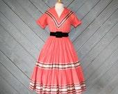 RESERVED...1950s Patio DRESS / Metallic SW Western Squaw in Papaya Pink, l-xl