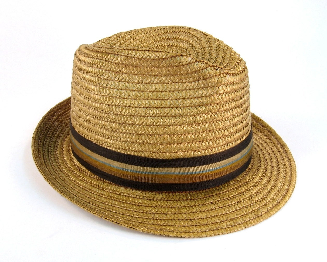 Men's Straw Hats in a wide variety of styles and colors to choose from. Everything from trendy stingy brim straw fedoras to the classic and timeless styling of the Panama fedora. You will find many straw hats for men at Village Hat Shop.