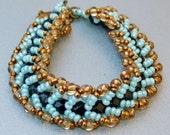 Charm Turquoise Beadwoven Bracelet  Khamsa amulet clasps.