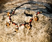 African Tribal skull necklace. Orange, yellow, black, Unisex, ethnic. Fathers day gift idea