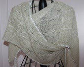 Nona's one-of-a-kind hand knit  lacey wrap/shawl