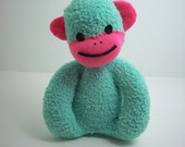 A Sock Monkey for Babies in Teal and Pink